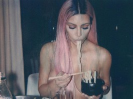 Reality TV personality Kim Kardashian has shared a photograph in which she is seen eating ramen while she is topless. In the image, Kim, 37, is seen topless while eating. Her hands and freshly-dyed pink hair were positioned to partially cover her breasts.