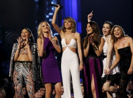 Taylor Swift (C) introduces a performance by Van Halen with Zendaya (L), model Martha Hunt, (2nd L) model Lily Aldridge, actress Haille Steinfeld and actress Ellen Pompeo during the 2015 Billboard Music Awards