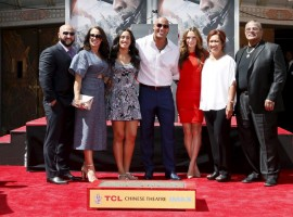 Dwayne 'The Rock' Johnson poses with his family during his hand and footprints ceremony