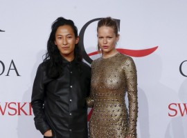 Designer Alexander Wang and model Anna Ewers arrives for the 2015 CFDA Fashion Awards