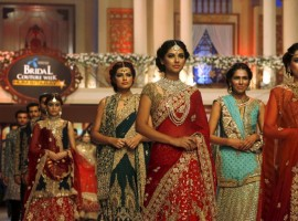 Models present creations by Pakistani designer Hassan Sheheryar Yasin (HSY) during Bridal Couture Week in Karachi
