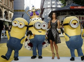 Actress Sandra Bullock poses with characters in costume from the film during the 'Minions' World Premiere at Leicester Square in London