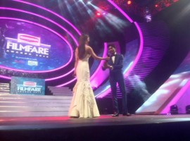 Kajal Agarwal presents the Best Actor Award to Dhanush