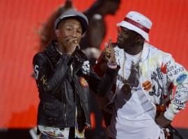 Pharrell Williams (L) and Sean 'Diddy' Coombs perform during the 2015 BET Awards