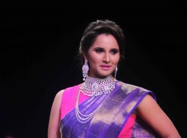 Indian Tennis Player Sania Mirza walks the ramp at India International Jewellery Week.