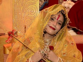 Self-styled godwoman from Punjab Radhe Maa is being sued for obscenity. Her photos wearing short pink dress has gone viral.