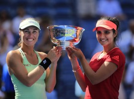 Sania Mirza and Martina Hingis beat Casey Dellacqua and Yaroslava Shvedova 6-3, 6-3 to win the US Open women's doubles title in New York on Sunday.