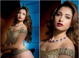 Cute Tamannah looks gorgeous in Manish Malhotra's designs with wavy hair and glossy red lips.