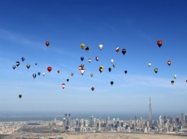 Hot air balloons fly over Dubai during the World Air Games 2015, held under the rules of the Federation Aeronautique Internationale (FAI) as part of the