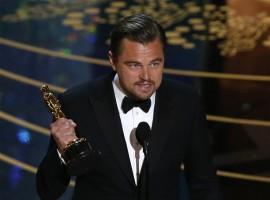 Leonardo DiCaprio holds the Oscar for Best Actor for the movie