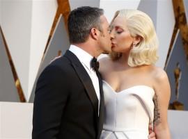 Presenter Lady Gaga arrives with boyfriend Taylor Kinney at the 88th Academy Awards in Hollywood, California.