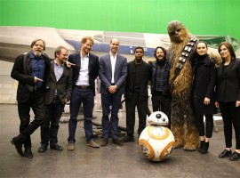 (L-R) Actor Mark Hamill, director Rian Johnson, Prince Harry, Prince William, actor John Boyega, Chewbacca and actress Daisy Ridley pose during a tour of the Star Wars sets at Pinewood studios in Iver Heath, west of London, Britain on 19th April 2016.