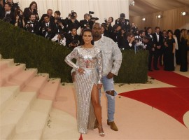 Musician Kanye West (R) and wife Kim Kardashian arrive at the Metropolitan Museum of Art Costume Institute Gala (Met Gala) to celebrate the opening of