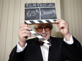 Cannes, France Director George Miller, President of the 69th Cannes Film Festival, holds a film clapper on the eve of the festival opening in Cannes, France, May 10, 2016.