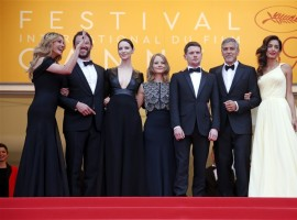 Director Jodie Foster (C) and cast members Julia Roberts, Dominic West, Caitriona Balfe, Jack O'Connell, George Clooney and his wife Amal Alamuddin pose on the red carpet as they arrive for the screening of the film