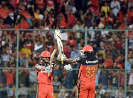 Hosts Royal Challengers Bangalore (RCB) dethroned Kings XI Punjab on early Thursday by 91 runs in a must-win league tie to keep its hopes of a place in play-offs alive in the IPL-9 season at the Chinnaswamy stadium. Chasing an imposing target of 212 in 15 overs RCB had set by piling up a whopping 211 for three wickets in 15 overs after heavy rain delayed the match by 110 minutes on Wednesday night, Kings scrambled to make 120 for 9 wickets in 14 overs, when sudden rain again forced the umpires to call off the match.