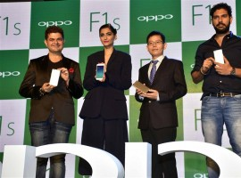 Indian cricket player Yuvraj Singh and Bollywood actor Sonam Kapoor during the launch of Oppo F1S smartphone.