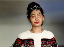 An Indian model scarred in an acid attack challenged perceptions of beauty as she strutted down the runway at New York Fashion Week to promote a ban on the sale of corrosive substances used to maim thousands of women and children each year.