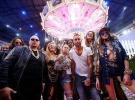 German designer Philipp Plein (C) poses with U.S. singer Fergie (4th L) and model Paris Hilton (3rd L) at the end of his fashion show during Milan Fashion Week Spring/Summer 2017 in Milan, Italy.