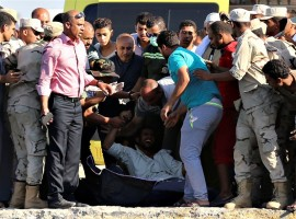Rescue workers carry the body of a victim on a stretcher after a boat carrying migrants capsized off Egypt's coast, in Al-Beheira, Egypt. A boat carrying hundreds of migrants capsized in the Mediterranean Sea off the coast of Egypt, officials said, with a death toll to 52. Security officials said almost 600 people may have been squeezed aboard the wooden vessel, suggesting hundreds more may have perished in what is just the latest disaster for migrants desperate to reach Europe.