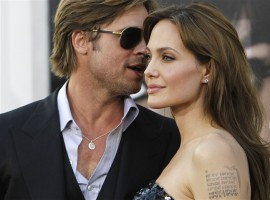 Angelina Jolie and Brad Pitt attend the premiere of the movie
