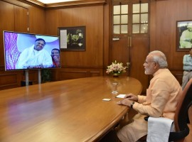PM Narendra Modi interacts with Mata Amritanandamayi 'Amma' through video conferencing.