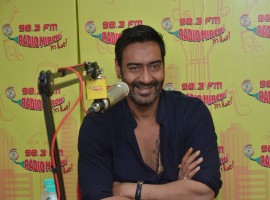 Photos of Bollywood actor Ajay Devgan at Radio Mirchi for the promotion of Shivaay.