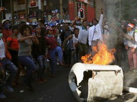 Students demanding free education chant slogans in front of burning barricade outside the University of the Witwatersrand at Braamfontein, in Johannesburg, South Africa.