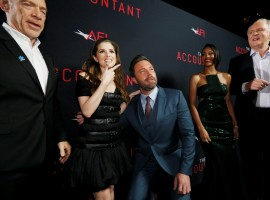 Cast member Ben Affleck (3rd L) poses with co-star Anna Kendrick (2nd L), as cast members J.K. Simmons (L), Cynthia Addai-Robinson and John Lithgow watch, at the premiere of