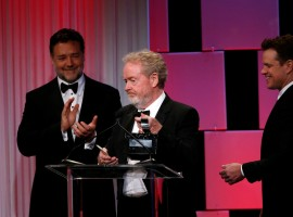 Director Ridley Scott accepts the American Cinematheque Award, as actors Russell Crowe (L) and Matt Damon stand nearby.