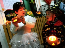Children in costumes hold pumpkin lanterns as they celebrate the upcoming Halloween at a kindergarten in Jinan, the capital of east China's Shandong province.
