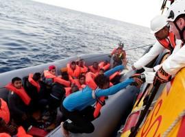 Migrants are seen during rescue operation in the Mediterranea Sea.