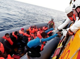 Migrants are seen during rescue operation in the Mediterranea Sea.