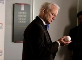 Actor, comedian and Chicago Cubs fan Bill Murray look at a baseball as he arrives to receive the 19th annual Mark Twain Prize for American Humor at the Kennedy Center in Washington.