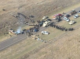 Protestors against the Dakota Access Pipeline stand-off with police in this aerial photo of Highway 1806 and County Road 134 near the town of Cannon Ball, North Dakota.