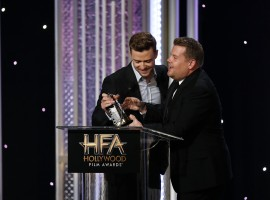 Actor James Corden congratulates musician Justin Timberlake (L) as he accepts the Hollywood Song Award for