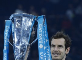 Andy Murray of Britain celebrates with the ATP World Tour Finals trophy after winning the men's singles final against Serbia's Novak Djokovic at the 2016 ATP World Tour Finals at the O2 Arena in London, Britain on Nov. 20, 2016. Murray won 2-0.