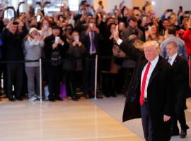 President-elect Donald Trump reacts to a crowd gathered in the lobby of the New York Times building. Trump, who has never previously held public office, was quick to bristle at unflattering news coverage during the campaign, even as he remained accessible to certain reporters, including several from the Times.