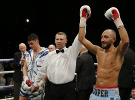Britain Boxing - Bradley Skeete v John Thain British Welterweight Title - Brentwood Centre - 25/11/16 Bradley Skeete celebrates winning the fight as John Thain looks on dejected Mandatory.