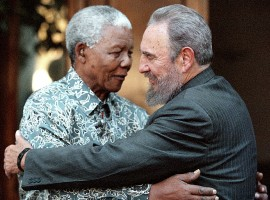 Former South African President Nelson Mandela (L) hugs Cuba's President Fidel Castro during a visit to Mandela's home in Houghton, Johannesburg in this September 2, 2001 file photo. Ailing Cuban leader Castro said on February 19, 2008 that he will not return to lead the country, retiring as head of state 49 years after he seized power in an armed revolution.