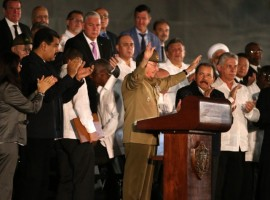 Cuban President Raul Castro acknowledges the applause from the crowd as he attends a massive tribute to Cuba's late President Fidel Castro in Revolution Square in Havana.