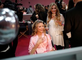 Model Megan Williams gets ready backstage before the Victoria's Secret Fashion Show at the Grand Palais in Paris, France, November 30, 2016.