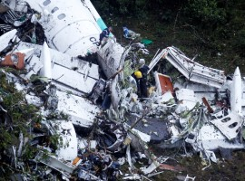 Rescue crew work at the wreckage from a plane that crashed into Colombian jungle with Brazilian soccer team Chapecoense near Medellin, Colombia, November 29, 2016.