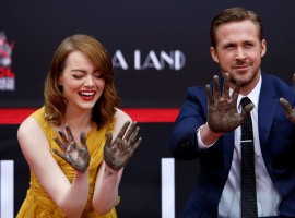 Photos of Emma Stone and Ryan Gosling place their hands in cement at the TCL Chinese theatre in Hollywood.