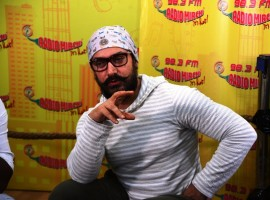 Photos of Bollywood actor Aamir Khan promotes Dangal movie at Radio Mirchi studio.