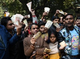 People stage a demonstration outside the Reserve Bank of India (RBI) building after the apex bank turned away people trying to exchange old currency notes in New Delhi on Jan 3, 2017.