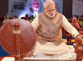In a surprise development, Prime Minister Narendra Modi has aejected Father of the Nation Mahatma Gandhi in the 2017 wall calendars and table diaries published by the Khadi Village Industries Commission (KVIC), official sources said here on Thursday.