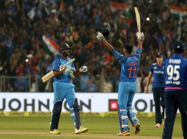 Virat Kohli and Kedar Jadhav slammed quickfire centuries to steer India to a three-wicket victory over England in the first One-Day International at the Maharashtra Cricket Association Stadium here on Sunday. Chasing a difficult 351-run target, the hosts were tottering at 63/4 when the duo came together to add 200 runs between them in 24.3 overs. India now lead the three-match series 1-0.