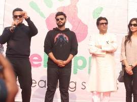Maharashtra Navnirman Sena (MNS) president Raj Thackeray, actors Arjun Kapoor and Priya Wal during the Lokhandwala Street Festival.