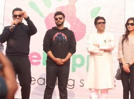 Maharashtra Navnirman Sena (MNS) president Raj Thackeray, actors Arjun Kapoor and Priya Wal during the Lokhandwala Street Festival.